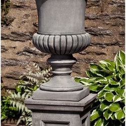 Campania International - Campania International Kent Urn Planter with Barnett Pedestal - PPD-643-AL - Shop for Planters and Pottery from Hayneedle.com! A recessed panel pedestal and statuesque urn give the Campania International Kent Urn Planter with Barnett Pedestal its panache. Designed to work in any outdoor setting this two-piece set is stylish and practical. Made of lightweight and durable cast stone that beautifully withstand the elements this planter and pedestal set come in a variety of aged finish options. Campania Cast Stone: The ProcessThe creation of Campania's cast stone pieces begins and ends by hand. From the creation of an original design making of a mold pouring the cast stone application of the patina to the final packing of an order the process is both technical and artistic. As many as 30 pairs of hands are involved in the creation of each Campania piece in a labor intensive 15 step process.The process begins either with the creation of an original copyrighted design by Campania's artisans or an antique original. Antique originals will often require some restoration work which is also done in-house by expert craftsmen. Campania's mold making department will then begin a multi-step process to create a production mold which will properly replicate the detail and texture of the original piece. Depending on its size and complexity a mold can take as long as three months to complete. Campania creates in excess of 700 molds per year.After a mold is completed it is moved to the production area where a team individually hand pours the liquid cast stone mixture into the mold and employs special techniques to remove air bubbles. Campania carefully monitors the PSI of every piece. PSI (pounds per square inch) measures the strength of every piece to ensure durability. The PSI of Campania pieces is currently engineered at approximately 7500 for optimum strength. Each piece is air-dried and then de-molded by hand. After an internal quality check pieces are sent to a finishing department where seams are ground and any air holes caused by the pouring process are filled and smoothed. Pieces are then placed on a pallet for stocking in the warehouse.All Campania pieces are produced and stocked in natural cast stone. When a customer's order is placed pieces are pulled and unless a piece is requested in natural cast stone it is finished in a unique patinas. All patinas are applied by hand in a multi-step process; some patinas require three separate color applications. A finisher's skill in applying the patina and wiping away any excess to highlight detail requires not only technical skill but also true artistic sensibility. Every Campania piece becomes a unique and original work of garden art as a result.After the patina is dry the piece is then quality inspected. All pieces of a customer's order are batched and checked for completeness. A two-person packing team will then pack the order by hand into gaylord boxes on pallets. The packing material used is excelsior a natural wood product that has no chemical additives and may be recycled as display material repacking customer orders mulch or even bedding for animals. This exhaustive process ensures that Campania will remain a popular and beloved choice when it comes to garden decor.About Campania InternationalEstablished in 1984 Campania International's reputation has been built on quality original products and service. Originally selling terra cotta planters Campania soon began to research and develop the design and manufacture of cast stone garden planters and ornaments. Campania is also an importer and wholesaler of garden products including polyethylene terra cotta glazed pottery cast iron and fiberglass planters as well as classic garden structures fountains and cast resin statuary.