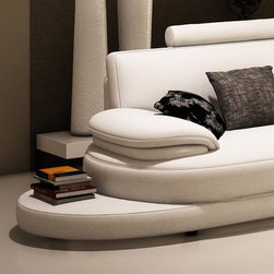 Caliaitalia 954a -modern sectonal sofa - This contemporary sectional sofa will add instant appeal to your living space. Its soft curvy appearance has all the features to make it the stylish and favored seat of the house. It comes upholstered in genuine high quality Italian Leather where you body touches the seat.