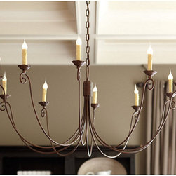 "Ballard Designs - Cosette 10-Light Chandelier - 5"" ceiling canopy and 6' hanging chain. Hand finished. The expressively curled arms of our 10-light Cosette Chandelier make a strong statement while still feeling light and airy. Wrapped with wire at the top, the graceful arms extend out into a gentle scroll under ruffled candle cups. Crafted of metal with a rust finish and cream drip candle sleeves.Cosette Chandelier features:. ."