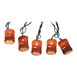 Zeckos - Friki-Tiki 10 Piece Natural Tiki Patio String Light Set - This 10 light string of Polynesian style tiki mask lights adds an island atmosphere to your patio. The light string is about 10 feet long, with Christmas tree style lights inside the 2 inch high barrel shaped tikis. They plug into standard North American power outlets, are UL listed, and come with 2 replacement bulbs.
