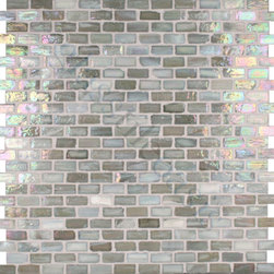 "Glass Tile Oasis - Silver 1/2"" x 1"" Silver Pool Glossy & Iridescent Glass - Sheet size:  12 1/2"" x 12 1/4"".        Tile Size:  1/2"" x 1""        Tiles per sheet:  276        Tile thickness:  1/4""        Recycled Components:   70%        Sheet Mount:  Paper Face     Sold by the sheet    -  Brilliant glass combed through with coordinating colors and available in 14 mouth-watering colors  in both Iridescent and Frost finishes.Waterfall tiles are hand-poured and will have a certain amount of variation and variegation of color  tone  shade and size. Additionally  you will notice creases  wrinkles  shivers  waves  bubbles topped off with a natural surface to catch all forms of light for a brilliant effect. These characteristics of natural glass and only serve to enhance the final beauty of the installation."
