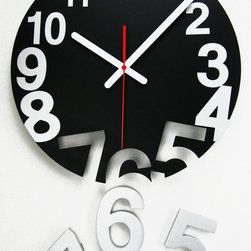 None - Novelty Number Gravity Pop Off Wood Clock - This fun 14-inch solid wood clock features metal hands in a white finish and dial in a solid black finish. Clock comes with pop up silver numbers that can be taped or hooked to your wall.