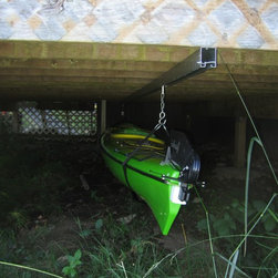 Under Deck Kayak Storage - We offer a full line of sliding hardware and  it is not just for doors!  Get creative with our products.  Use our hardware traditionally or come up with a new use, like this great storage solution!