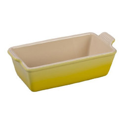 Le Creuset - Le Creuset Heritage Stoneware 1.5 qt. Loaf Pan - Soleil - PG1049-23 1M - Shop for Bread Baking from Hayneedle.com! Make morning brighter by baking and serving your quick breads in this Le Creuset Heritage Stoneware 1.5 qt. Loaf Pan - Soleil. Its sunny yellow enamel coating outside and creamy coating inside resist scratches and stains so it's as durable as it is gorgeous. Vintage-inspired design and built-in scalloped handles add to the charm. Not just a pretty face this loaf pan is made of sturdy stoneware that provides perfect even heat without scorching. Use it in the freezer microwave oven broiler and even the dishwasher.About Le Creuset of America Inc.From its cast iron cookware to its teakettles and mugs Le Creuset is a global standard of inimitable color and quality. Founded in 1925 in the northern French town of Fresnoy-Le-Grand Le Creuset still produces enameled cast iron in its original foundry. Its signature color Flame was modeled after the intense orange hue of molten cast iron within a cauldron (or creuset in French) and has been a Le Creuset bestseller from the company's first year to the present day.Though best known for its vibrantly colored cookware and original inventions such as the Dutch oven Le Creuset has also forged a name as a creator of stoneware mugs and enamel-coated stainless steel teakettles. The style and performance of Le Creuset's Cafe Collection and tea accessories are rooted in classic French cookware: bold colors cylindrical loop handles unmatched thermal resistance and heat distribution and of course the iconic Le Creuset three-ring accent. Through its consistent qualities of authenticity originality and innovation Le Creuset maintains a connection to both heritage and modernity.