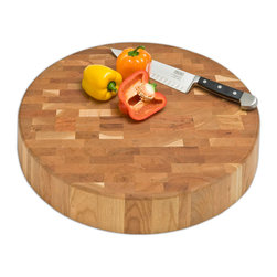 "J.K. Adams - Cherry Chunk Board, 18"" Round - Prized for patterns as well as the way its surface preserves knife blades, an end-grain cutting board is a crucial component in your kitchen. Choose from this selection of stunning cherry boards and start chopping like a true chef."