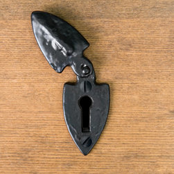 Hand-Forged Iron Arrow Keyhole Escutcheon - Black Powder Coat - This keyhole cover features a decorative, arrowhead shape and is perfect for desks or other furniture where a faux keyhole would be appropriate.