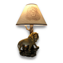 Sculpted Lion Accent Lamp with Printed Fabric Shade - This lovely lamp will delight both nature and lion lovers alike with an expertly sculpted life-like lion standing on a rocky, grassy base keeping watch over his kingdom. Made of cold cast resin, this exquisitely hand-painted lamp stands 19 inches tall, is 9 inches wide and 5 inches deep. The tube of the lamp is shaped and looks just like an old tree, with time worn bark that looks as if it`s been scraped off by the wild animals of the jungle and topped off with a lovely lustrous sateen finish 14 inch diameter tan shade that`s trimmed in a complementing brown and features a realistic lion`s head silhouette. The 4 foot, 6 inch long cord has a convenient in-line thumb-wheel on/off switch, and includes 1 type A 45 watt bulb to light up your life and your space!