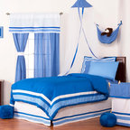 Simplicity Blue - Full Set (4pc no sheets) - Let your personality come to life in a room filled with sophistication and style.  Simplicity Blue is nothing too simple for you!  Beautiful hues of blue with white throughout make the most of this set.  This 4pc set includes full comforter, full bed skirt, 2 standard flanged pillow shams.  Comforter comes a beautifully framed design in shades of dark blue, light blue and white.  Opposite side is in solid darker blue.  All in cotton print fabric.   Bed skirt designed with lines of white and both color blues in cotton print fabric. Standard flanged sham designed to replicate comforter in design.  All in cotton print fabric.  SAVE WHEN YOU BUY AS A SET!