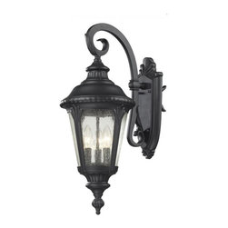 Three Light Black Clear Seedy Glass Wall Lantern - Traditional and timeless, this medium outdoor wall mount combines black cast aluminum hardware with seedy glass for a classic look.