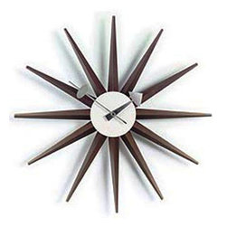 George Nelson - Sunburst Clock - With wood spokes in a rich walnut finish, this classic sunburst clock will be an appealing way to add sculptural interest to any decor. A reproduction of a George Nelson classic, the clock is battery operated and will be a dynamic addition to a great room, dining room or entry. Uses 1 AA battery (not included). George Nelson classic design. Attractive sculptural shape. Perfect for any interior space including the home or the office. Made of wood and metal. 2.5 in. D x 18.5 in. W x 18.5 in. H (1.54 lbs.)The Nelson Classic Wooden Sunburst Clock was designed by George Nelson in the 1950's. The Sunburst Clock is one of the most recognized clocks in modern day history and provides a bright alternative to the less-than-exciting standard time pieces. The Sunburst Clock is widely considered to be one of George Nelson's most beloved design creations. This clock is one of the signature pieces in George Nelson Vitra clock collection. This mid century modern wall clock is an icon of modern design. This clock is battery powered with 1 AA battery and has a quartz driven mechanism. The highly decorative George Nelson clock collection is perfect for any interior space including the home or the office. These modern wall clocks have an attractive sculptural shape and they are a refreshing alternative to the usual traditional timekeepers.