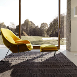 """Saarinen Womb Chair - Eero Saarinen designed the groundbreaking Womb Chair at Florence Knoll's request for """"a chair that was like a basket full of pillows, something I could really curl up in."""""""