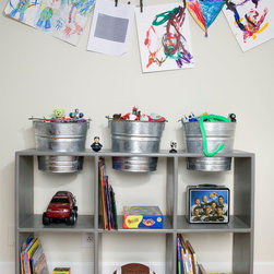 Nancy Gent Designs - TEDDY Organizer - I designed TEDDY with removable buckets when I saw my young son carrying his bath toys down the hallway and dropping most of them.  I told him I would design a piece that allowed him to keep all of his bath toys in removable bucket.  After his bath Liam would pile the wet toys back in the bucket and set back in place, and the wet toys did not cause the galvanized bucket to rust.  We used the other buckets for Lego's and other small toys.  This piece enabled him to pull the bucket out and transport his building toys anywhere in the house to play.  Made of solid poplar and-tooled by Amish craftsmen in Ohio.  Wipe down with damp cloth.