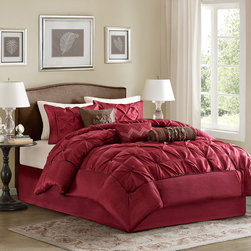 Madison Park - Madison Park Laurel 7 Piece Comforter Set - This beautifully tufted bed is from the Laurel bedding collection. Its deep red coloring makes this set create a statement in your bedroom. The collection is made from 100% polyester polyoni and has pieced fabric sewn together to give this set dimension. It is finished with a smooth edge of fabric that creates a beautiful border around this comforter. Comforter & Sham: 100% polyester polyoni pieced with pleats, 100% polyester brushed fabric back, 270g/m2 poly fill Bedskirt: 100% polyester fabric drop, poly platform Pillow: 100% polyester polyoni cover with polyester fill