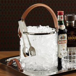 Equestrian Ice Bucket With Leather Handle - A heavy stitched leather strap makes it easy to carry the Equestrian Ice Bucket, but its primary purpose is to add a welcoming warmth to the appearance of your barware.  Versatile and casual, but suggesting the gentility possible with low-key adornments made in high quality, the ice bucket has clear glass walls and a bright polished nickel rim for a clean, inviting look.