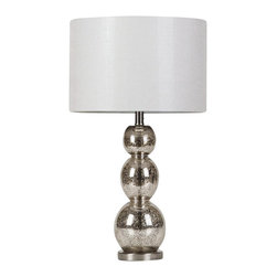 Coaster - Coaster Metallic Finish Table Lamp - Coaster - Table Lamps - 901185 - This metallic finish table lamp features a uniquely shaped base and mottled tortoiseshell finish that blends seamlessly with existing decor. A single metal circle anchors the base of the lamp and is topped with three spherical shapes in assorted sizes. Swirls dapples and a hint of metallic shine come together to form a beautiful and intriguing finish on the base. A muted white drum shade tops the lamp's distinctive base for an understated finish that won't distract from the beautiful swirled designs of the base below.
