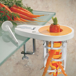 Paderno World Cuisine - Upright Carrot Peeler - The carrot peeler is designed for carrots with a unique postitioning of the six opposing blades. With one smooth downward movement the carrot is peeled. The blades are on springs to accommodate varying diameters.