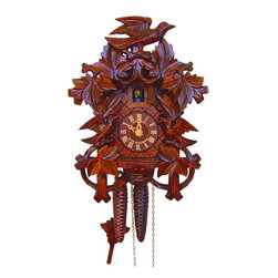 Schneider Cuckoo Clocks - 1-Day Wooden Dancers Cuckoo Clock in Honey Finish - 1-day rack strike movement. Top execution solid wooden case. Extra deep and detailed carving. Wooden cuckoo, dial with roman numerals and hands. Shut-off lever on left side of case silences strike, call and music. Wooden cuckoo calls and strikes every half and full hour. Automatic night shut off. Made from wood. Made in Germany. 7.5 in. W x 5.9 in. D x 10.6 in. H (3.1 lbs.). Care Instructions