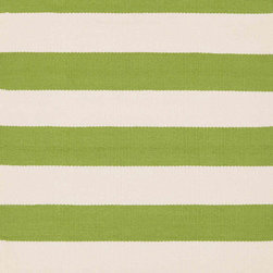 Catamaran Stripe Sprout/Ivory Indoor/Outdoor - Wide green and ivory stripes feel fresh for spring. I am planning to lay down a pair of these Dash & Albert indoor/outdoor rugs on my own porch, though they would be awesome in a kid-friendly living room too.