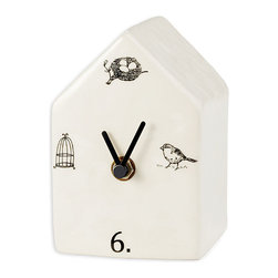 Ceramic Birdhouse Clock - Appealing wingding line drawings suggest the pleasures of na�ve art and the allure of the vintage in this tabletop Birdhouse Clock, which whimsically indicates six o'clock along with a trio of bird-related icons � time to nest, time to fly, and time to return to the birdcage for a rest.  A playful addition that lends loose geometry to a transitional interior, the useful clock is especially charming on a mantel or desk.