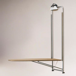 Over-the-door Ironing Board - This over-the-door ironing board with a built-in iron holder is functional and saves space — bonus! It's even affordable. This is a must.