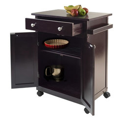 Winsome Wood - Kitchen Cart in Espresso Finish - One large drawer. Two doors. One fix slated shelf. Bottom shelf. Handle and accent knobs. Easy to move with four casters. Made from solid and composite wood. Assembly required. Drawer: 19.29 in. W x 13.31 in. D x 3.23 in. H. Middle shelf: 22.52 in. W x 12.91 in. D. Overall: 26.89 in. W x 17.72 in. D x 34.02 in. H