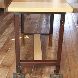 Rolling Bar Height Dining Table - Made from 100% reclaimed bamboo doors with salvaged madrone and walnut inserts. The base is 100% reclaimed angle iron steel combined with a bamboo butcher block foot rest and 70's urethane skateboard wheels! Photo: Cam Schiff