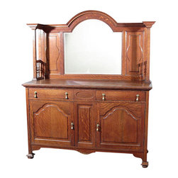 Antiques - Antique Oak Victorian Buffet Sideboard Server - Country of Origin: England. Circa 1920. Oak finish. Scalloped backsplash. Scalloped beveled mirror. Tapered columns w/ spindles. 2 Dovetail drawers. Brass pulls. 2 Cabinets w/ 4 shelves, 2 removable Paneled doors. Flat bun feet w/ metal hardware. Victorian style. Maker's mark: Morgan & Co, The Hayes, CardiffCondition: It has age appropriate wood imperfections including scratches, small white spots, marks, wood separations and a small hole in one shelf.