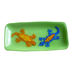 Vivian Stearns-Kohler/Etoile Creations - Fused glass - Geckos - Two gecko friends in colors of orange with yellow and royal blue with orange share a lime green background. The geckos were created with crushed glass (frit).