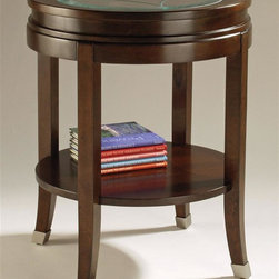 Magnussen Furniture - Round End Table - Lakefield - Lakefield, a new vision which blends distinctive designs, superlative materials and craftsmanship. All pieces are rendered in birch solids and cherry veneers with a Merlot finish. Note our saber legs ending in brushed chromed caps. Select pieces display etched glass tops with one inch glass bevels. The collection conveys a sophisticated quality through its refined architectural lines. 20 1/2 in. W x 20 1/2 in. D x 25 in. H