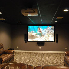 Contemporary Home Theater by Rittenhouse Builders