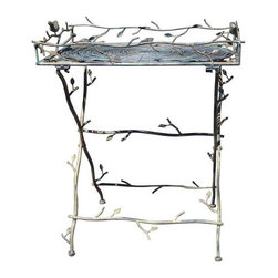 Pre-owned Iron Bird Table - Purchased from a store in Westport, Connecticut, this Iron Bird table caught the seller's attention with its solid iron and a beautiful green verdigris finish. This table can be unscrewed at the four corners and the top comes off and the legs fold for easier moving and storage.