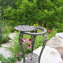 Oakland Living - Oakland Living Vineyards Wrought Iron Antique Bronze Planter - Our plant table stands are the perfect addition to any setting bringing beauty and style both indoors and out. Constructed of durable cast iron with interchangeable top this grape table plant stand features a hardened powder coated finish for years of beauty. The Oakland vineyard collection is perfect for fruit and wine lovers alike. Each piece is adorned with twisty grape vines and ripe clusters of grapes. The attractive grape vines will add beauty and style to any outdoor patio garden setting. Each piece is hand cast and finished for the highest quality possible.For more than 15 years Oakland Living has been making wrought iron aluminum and resin wicker patio furniture and has built a reputation around their quality construction and superior value. Their furniture is made to weather even the most inclement conditions and stay looking good year after year. Because their items are warehoused here in the U.S. you will enjoy quick shipping on all your patio furniture purchases. Features include Easy to Follow Assembly Instructions and Product Care Information Metal Hardware Some Assembly Required 1 Year Limited Manufacturers Warranty Other Items Available in Collection We recommend that the products be covered to protect them when not in use. To preserve the beauty and finish of the metal products we recommend applying an epoxy clear coat once a year. However because of the nature of iron it will eventually rust when exposed to the elements.. Specifications Finish: Antique Bronze.
