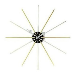 Vitra - Star Clock by Vitra - A classic timeless design! This beautiful Star Clock in was designed by George Nelson in 1955 and has become an Icon of Modern Design. This is an authentic re-edition, fully authorized by the Nelson estate.Chrome and Brass with high grade quartz clockwork. Free battery included.Shipping:This item usually ships within 3 to 5 business days.Dimensions:Diameter 24 in.
