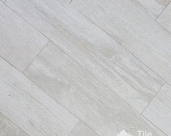 Crate Series - Colonial White Wood Plank Porcelain Tile - Some of your greatest childhood memories are of spending summers on your grandfather's farm: the animals, the wilderness, the endless runs through the cornfields and the time spent playing in his white barn. When you decided that it was time to redecorate your home, you wanted to use these memories as inspiration and found the perfect flooring with this in mind: Colonial White wood plank porcelain. This tile that looks like wood features a whitewashed HD print on the surface that recreates wood grain patterns and textures. At first glance, you had trouble believing that this was porcelain because you thought it was real hardwood! Once your Colonial White wood plank porcelain was installed, your home looked brighter and happier, just like you wanted.