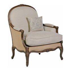 Chloe Oversized French Country Burlap Linen Bergere Accent Chair - Fall into a plush reproduction oversized arm chair, exquisitely finished with tacks and contrasting natural burlap and linen fabric. The chair is accompanied by a faded toile linen throw pillow and fits naturally in an intimate reading nook or as a focal piece in a sitting room. Inspired by a uniquely large antique chair, the Chloe Chair has an optional footstool.
