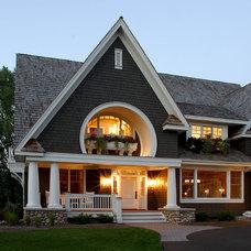 Traditional Porch by Sharratt Design & Company