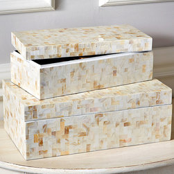Mother of Pearl Boxes - Set of 2 - Flawlessly simple forms make this elegant pair of coffers perfect for the desktop, the bath, the dresser, and the mantel. The Set of Two Mother of Pearl Boxes provides out-of-sight storage for small treasures along with a timeless gleam in ivory and white. Lids fit onto the boxes without fuss, creating rectangular pedestals or simply enclosing the essentials within.