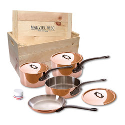 Mauvel M'Heritage 150c 7 Piece Copper Cookware Set W/ Wooden Crate - The Mauviel M'Heritage 7 piece cookware set allows you to cook with unsurpassed heat conductivity and control thanks to it̥s 90% copper  10% stainless steel construction.  The M̥150c collection features classic cast iron handles  stainless rivets  a polished copper exterior  and an 18/10 stainless interior.  The cookware has a thickness of 1.5 mm  and the copper exterior allows for superior heat conduction and control.  The M'Heritage collection represents the total experience and heritage of Mauviel 1830.  This set comes packaged in a traditional and attractive wood crate  a great touch for gift presentation.  Set includes      1.9 qt Saucepan (6410.17)   1.9 qt Saucepan Lid   3.2 qt Saut�_ Pan (6411.25)   3.2 qt Saut�_ Pan Lid   3.6 qt Saucepan (6410.21)   3.6 qt Saucepan Lid   10.2 in Frypan   Copperbrill Cleaner     Product Features      Bilaminated copper stainless steel - 90% copper and 10% 18/10 stainless steel   Copper cookware heats more evenly and much faster than other metals  and offers superior cooking control   1.5 mm thickness   18/10 stainless steel interior preserves the taste and nutritional qualities of foods and is easy to clean   Mauviel M'150c cookware can be used on gas  electric  halogen stovetops  and in the oven. It can also be used on induction stovetops with Mauviel's induction stove top interface disc (sold separately)   Mauviel cookware is guaranteed for life against any manufacturing defects (Warranty not valid for commercial use)   Made in France