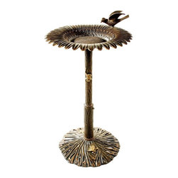 Oakland Living - Sunflower Design Bird Bath Embellished w Gard - Finish: Antique BronzeBirdbath constructed of aluminum and iron. Birdbath has a sunflower theme. High-grade polyester powder coat finish provides a long lasting, beautiful finish that will maintain it's appearance for years to come. Minimal maintenance. Electrostatic application of the powder coat insures a smooth, even finish. Quick and easy assembly is assured with step-by-step assembly instructions included. Double QC quality program in which each piece is assembled prior to being unassembled and packaged assures that all parts are present and that the product will assemble easily. Pictured in Antique Bronze. 34 in. H x 19 in. W x 19 in. D. Weight: 30 lbs.