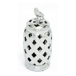 "Benzara - Stunning Tibetan Ceramic Silver Jar - Make your kitchen counter glow with this ceramic jar that has nickel plating and a bird shaped lid holder. This jar is unique and different because it is differently styled. The crisscross designs and the large piercings on the body and lid of the jar make it a stand out piece. You can use this jar just to display or to store in items. Apart from adding it to the counter you can place it on the table or inside the shelf.The tables and shelf is sure to look more attractive with this jar in there. This jar is indeed beautiful home accent and will suit all kinds of home interiors. The good quality built of this jar will keep it in good condition for years together. Apart from being a wonderful home decor, it is also an ideal gift option. So, present it to close ones and they will surely go wow at the sight of this pretty ceramic jar. This silver jar measures 8 inches (Width) x 8 inches (L) x 18 inches (Height) ; Nickel plated; Bird shaped lid holder; Dimensions: 11""L x 8""W x 19""H"