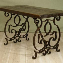 Large Harvest Iron Table - This large harvest table is truly unique. I love the large, distressed wood top with the rusted iron base. If rusted isn't your thing, there are multiple options to make sure it fits in with your decor.