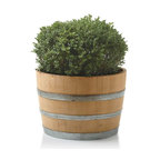 "Viva Terra - Wine Barrel Planter - We commissioned a local artisan to halve fine re-purposed oak wine barrels and drill a wide drain hole in the bottom to serve as weather-proof  planters. Made in USA. 28""D x 18""H"