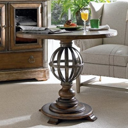 European Farmhouse Provencal Gardens Table - Eye-catching and elegant, the European Farmhouse Provencal Gardens Table makes a striking addition to any home. Versatile enough to take the place of a traditional nightstand, this decorative accent table works equally well in an entryway or living room. Inspired by classic garden topiaries, the antiqued-metal orb in the center sits on a sturdy base adorned with a series of stacked and carved disks, balls, and rings.Crafted from durable Dutch white cedar and cedar and ash burl veneers, this multipurpose table comes in two distressed finish options. Terrain is a rich, hand-waxed coffee tone with artisanal distressing, while blond offers a natural, close-to-the-wood matte finish with cream-colored accent glaze. The round tabletop is hand-finished to bring out the warm, lustrous beauty of the wood.The European Farmhouse CollectionEach piece of this unique European Farmhouse collection looks and feels like a prized antique store find, those once-in-a-lifetime discoveries that give your home its unique character. Eclectic accents and colors blend and complement each other like old friends, without being too matchy. Hand-waxed colors like dark coffee, chalkboard black, and honey blond enrich the Dutch white cedar veneer. Run your fingers across the silky sheen to feel the authentic antiqued distressing, then tickle the Old-World dangle pulls as if this furniture has long been part of your family.Stanley Furniture CraftsmanshipStanley Furniture's main objective is to produce quality and stylish furniture by using the best wood materials, construction procedures, and elegant finishes on their products to help you fashion your home decor the way you imagined. All of their furniture is hand-crafted from quality woods, incorporating other superior materials such as aluminum, glass, plastic, leather, and marble. Every joint is carefully constructed (keeping wood's sensitivity to heat and humidity in mind) allowing for expansion and contraction. All joints are held together with glue and nail.Stanley's 30-step finishing process starts with an undertone stain that is applied to a hand-sanded piece. Next, the stain is sealed with a wash coat, then hand sanded again with filler applied to pack the wood pores and smooth out the surface. A sealer coat is then applied, the piece is hand sanded again, and hand padded to mellow the tone. From there, a luster glaze is rubbed on by hand, followed by antiquing or distressing also done by hand. Finally, after drying, each piece is hand waxed and rubbed prior to final inspection.About Stanley FurnitureSince 1924, the goal of the Stanley Furniture Company has been to manufacture high quality furniture at a price the average American family could afford. To accomplish this goal, founder Thomas Bahnson Stanley surrounded himself with the finest furniture craftsmen and instilled in them a sense of pride in building superb quality into every piece of Stanley Furniture. Today, that pride is shared by more than 1,750 dedicated associates who have made Stanley Furniture one of the largest, most respected furniture manufacturers in the nation.