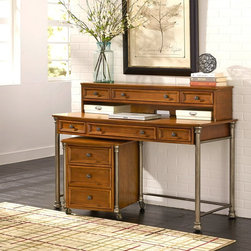 Home Styles - Home Styles The Orleans Executive Desk / Hutch / Mobile File - vintage caramel M - Shop for Desk Collections from Hayneedle.com! The Home Styles The Orleans Executive Desk / Hutch / Mobile File - Vintage Caramel is a hardworking team that brings 18th-century French Creole charm to your workspace. A warm vintage caramel finish coordinates nicely with the French Quarter-inspired cast metal feet and caps. The sturdy steel base is powder-coated with a gunmetal gray finish. Birch veneers with engineered wood are made to last while hardware details shine in an antiqued nickel finish. The desk accomodates your keyboard with a full-extension tray that glides smoothly on ball-bearing metal guides. Five desk drawers contain necessities and maintain order beneath an expansive 1 300-sq.-in. workspace. The mobile file features a storage drawer a large file drawer that holds letter and legal file sizes and four heavy-duty casters (two of them lock). Both of the mobile file's drawers run on full-extension ball-bearing metal guides. Assembly required.Dimensions:Mobile file: 20.5W x 21.25D x 23H in.Desk: 56W x 24D x 40H in. About Home StylesHome Styles is a manufacturer and distributor of RTA (ready to assemble) furniture perfectly suited to today's lifestyles. Blending attractive design with modern functionality their furniture collections span many styles from timeless traditional to cutting-edge contemporary. The great difference between Home Styles and many other RTA furniture manufacturers is that Home Styles' pieces feature hardwood construction and quality hardware that stand up to years of use. When shopping for convenient durable items for the home look to Home Styles. You'll appreciate the value.