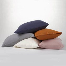 Coyuchi Jersey Envelope Pillowcases Standard Tangerine - Curl up in our sublime organic cotton jersey envelope pilloecases. Supremely soft and comfortable, just like your favorite vintage T-shirt.  Fill your bed with softness by purchasing pillowcases, sold in a set of 2. Pillowcase Set of 2 Dimensions: Standard- 20x32 Care: All of our cotton & linen products are machine washable. We recommend using warm water and non-phosphate soap in the washing cycle, with a cool, tumble or line dry. The use of bleaching agents may diminish the brilliance and depth of the colors, so we recommend not using any whiteners