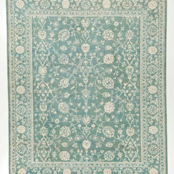 Rug Knots - Blue and White Silk Rug with Borders - This rug's simple blue and white color scheme compliments its intricate design perfectly. Marvel at the detailed motifs which are hand-knotted across this rug's 9x8 figure. Look closer at the soft blue which forms the background, and you'll see hints of seafoam green, sky blue, ivory, olive, and azure. This rich design element would place perfectly against dark furniture or sleek hardwood floors. Its balanced, symmetrical patterns attract the eye without overpowering it. This work of art was handcrafted at the RugKnots factory in Pakistan, meaning it's truly one of a kind.