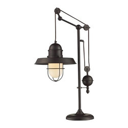 ELK Lighting - Table Lamp in Oiled Bronze Finish - Inspired by antique lighting, this series recalls turn-of the century design where simple aesthetics and mechanical function combined to create charming, yet versatile fixtures. These classic pull-downs have a decorative weight that counterbalances the fixture for easy height adjustability anytime by simply pulling down or lifting up on the fixture.