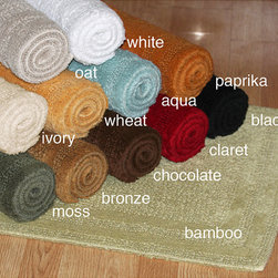 None - Cotton Reversible 18 x 25 Bath Mat - Liven up your bathroom with this cotton bath rug. The ring-spun,100 percent cotton rug is reversible and comes in a range of fashionable colors. Keep several of these machine-washable bath mats on hand to coordinate or contrast with your decor.