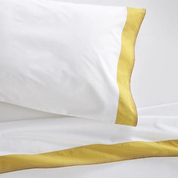 """Miri Yellow Twin Sheet Set - Pigment-dyed yellow trim bands crisp, white bedding in rich color, playfully accented with five rows of contrast stitching. Versatile look in soft, cotton percale mixes and matches for a varied, layered bed. Generous 16 """" pockets (14"""" for twin) accommodate most mattresses. Bed pillows also available."""