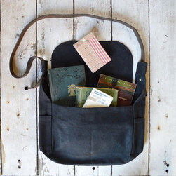 Man's Carry-All - Don't mistake this manly accessory for a purse. Made with waxed canvas and equipped with two internal pockets lined with antique fabric, it's as durable as it is suave. Go ahead, fill it with tools.